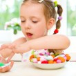 Stock Photo: Girl eating candies