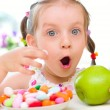 Girl eats candies — Stock Photo