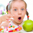 Girl eats candies — Stock Photo #28614681