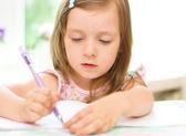 Girl writing — Stock Photo