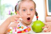 Girl eats candies — Stock Photo