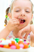 Girl eating candies — Stock Photo