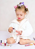 Little girl painting nails — Stock Photo