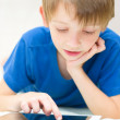 Boy using tablet computer — Stock Photo #30037003