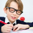 Schoolboy writing homework — Stock Photo
