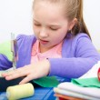 Stock Photo: Girl sewing