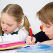 Schoolchildren writing in workbook — Stock Photo