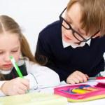 Schoolchildren writing in workbook — Stock Photo #30344451