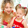 Child with mother painting — Stock Photo #30344471