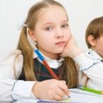 Schoolchildren writing in workbook — Stock Photo #30344473