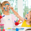 Two little girls painting — Stock Photo #30344599