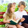Stock Photo: Portrait of cute kids reading book