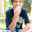 Boy teenager eating green apple — Stock Photo