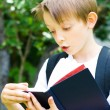 Schoolboy reading a book — Stock Photo