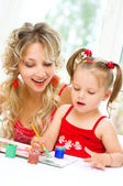 Child with mother painting — Stock Photo