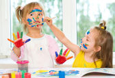 Two little girls painting — Stock Photo