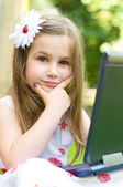 Girl using her laptop outdoor — Stock Photo