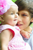 Teenage boy holding baby — Stock Photo