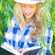 Stock Photo: Girl reading book