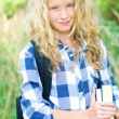 Teenager girl with backpack and books — Stock Photo #30731425