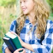 Stock Photo: Teenager girl with backpack and books