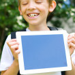 Schoolboy with tablet computer — Stock Photo