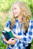 Teenager girl with backpack and books — Stock Photo