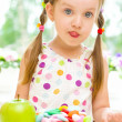 Child choosing between apple and sweets — Stock Photo #31054357