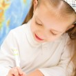 Child is writing in preschool — Stock Photo #31054889