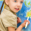Child in front of world map — Stock Photo #31055075