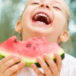 Kid eating watermelon — Stock Photo #31055453
