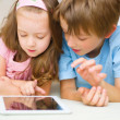 Stock Photo: Children using tablet computer