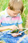 Little boy using tablet — Stock Photo
