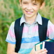 Schoolboy with backpack and books — Stock Photo