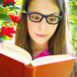 Girl reading a book — Stok fotoğraf