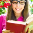 Girl reading a book — Stock Photo