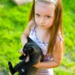 Child holding kitten — Stock Photo