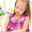 Little girl writing — Stock Photo