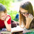 Kids reading a book — Stockfoto