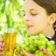 Stock Photo: Girl holding grapes