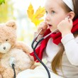 Stock Photo: Child is examining her teddy bear