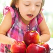 Child holding apples — Stock Photo