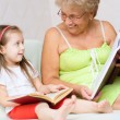 Great-grandmother reading a book — Stock Photo