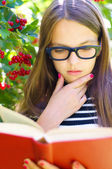 Girl is reading a book — Stock Photo