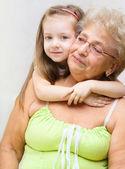 Granddaughter hugging her grandmother — Stock Photo