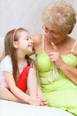 Grandmother talking to her granddaughter — Stock Photo