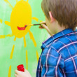 Boy painting on the wall — Stock Photo