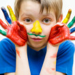 Kid with painted hands — Stock Photo