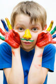 Kid with painted hands — Stock fotografie