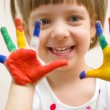 Child with painted hands — Stock Photo